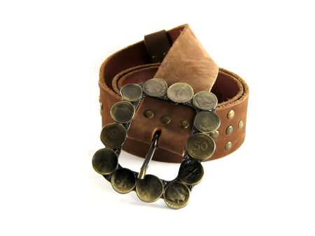 clasp: brown leather belt with coins on its buckle Stock Photo