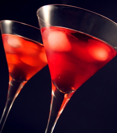 Two martini glasses with ice cocktail