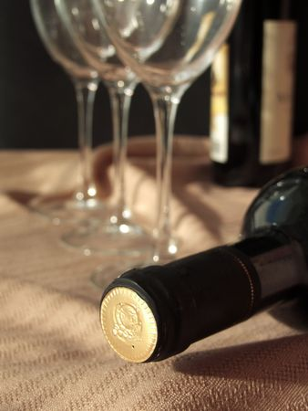 glasswear: Bottle of wine laying behind the wine glasses Stock Photo