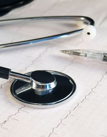 Stethoscope and pen laying on the cardiogram Stock Photo - 3564749