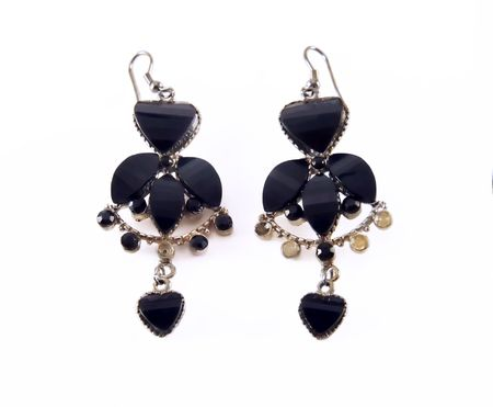 earing: Pair of black earing isolated on white