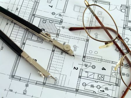 bluelines: Divider and spectacles laying on architectural plan