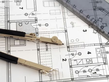 bluelines: dividers and ruler laying on architectural plan