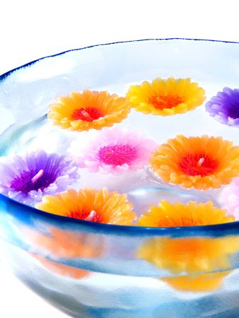 aromatherapy candles in a bowl with water photo