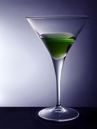 Cocktail glass with green beverage