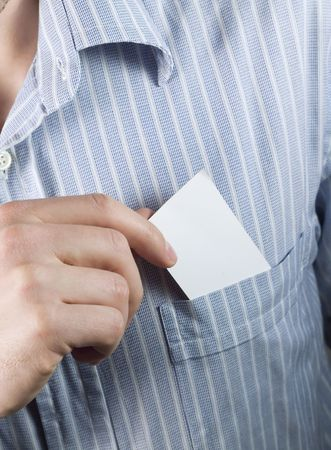 businessman taking out blank business card from his pocket photo