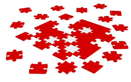 close up of isolated red  scattered  jigsaw puzzle pieces photo