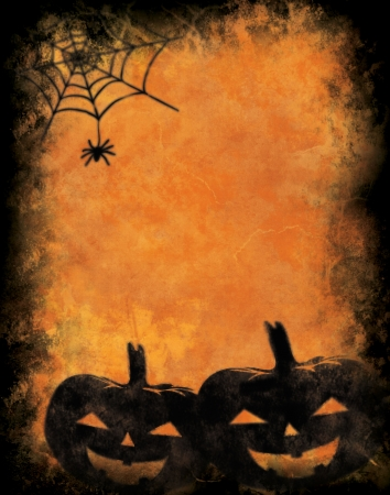 Grunge textured background with halloween pumpkins photo