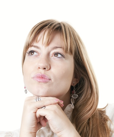 Closeup of a young attractive woman thinking photo