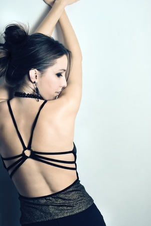 back posing: beautiful young woman in elegant dress