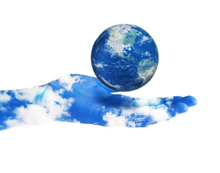 Planet Earth in hand painted with sky photo