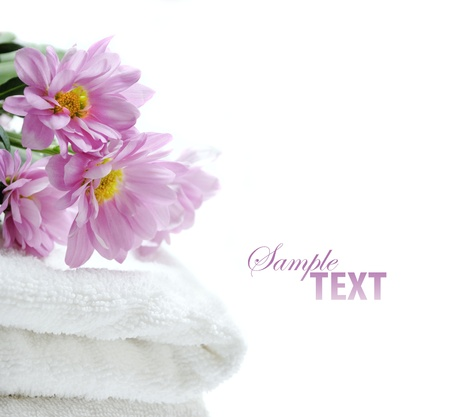 Clean towel with fresh flowers