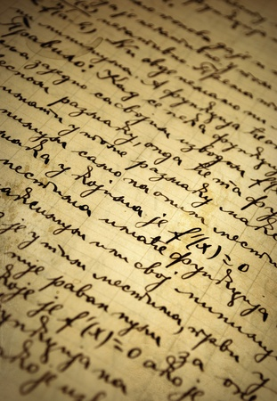 Closeup of an old manuscript written with ink photo