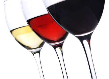 Three glass of wine over white background photo