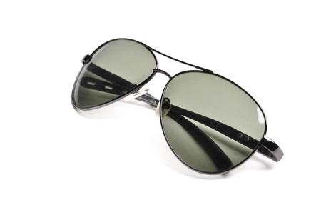 Black sunglasses isolated over white photo