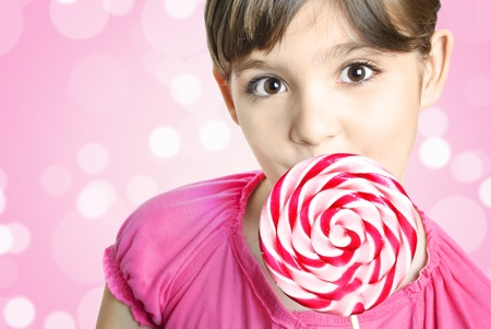 Beautiful little girl with lollipop  photo