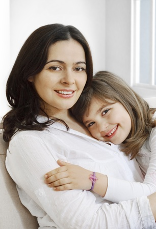 Portrait of happy mother and her smililing daugther Stock Photo - 9445038