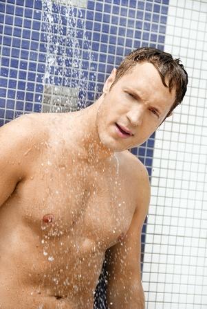 sexy shower: Portrait of handsome blond man under an outdoor shower Stock Photo