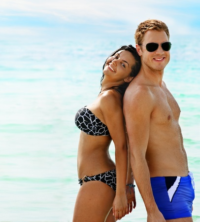 bikini couple: Beautiful smiling young couple having fun in the sea