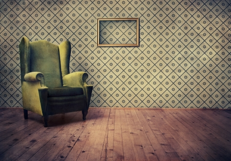 dirty room: Vintage room with wallpaper and old fashioned armchair Stock Photo