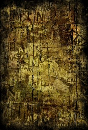 Grunge textured background with old torn newspapers photo