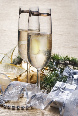 Two champagne glasses with presents and decorative ribbon photo