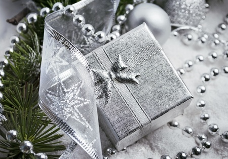 Silver gift box and christmas decoration in snow photo