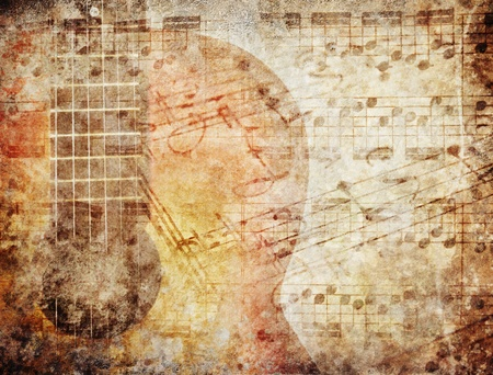 Grunge background with music sheets and guitar photo