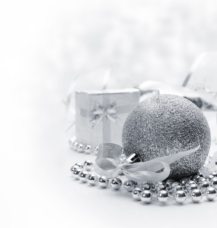 Silver christmas ornaments with bokeh background photo