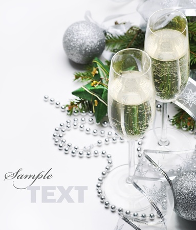 Two champagne glasses and christmas ornaments photo