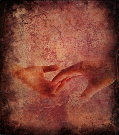 Touching hands over grunge background Imagens