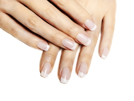 Beautiful female hands with french manicure isolated over white