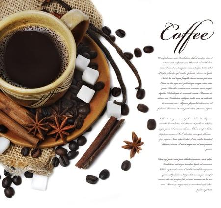 Coffee cup with vanilla, cinnamon, anise seed and sugar photo