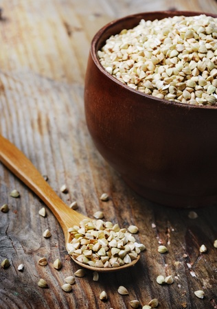 Buckwheat in bowl on wooden background Stock Photo - 12379256
