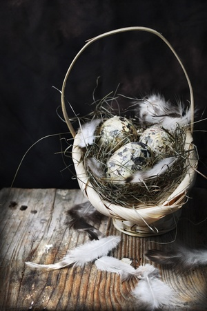 Easter eggs in basket on wooden background Stock Photo - 12803248