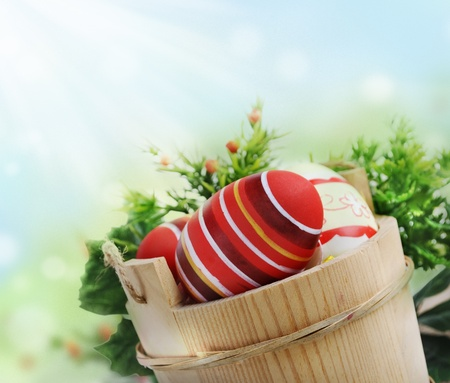 Easter eggs in wooden basket photo
