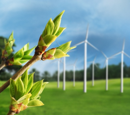 go green: Ecology concept. Renewable energy from wind turbines.