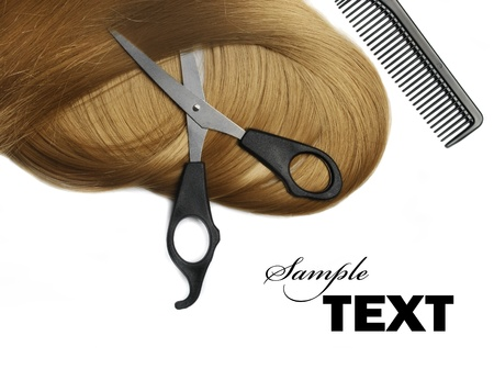 hairdressing scissors: Long healthy blond hair and professional scissors over white