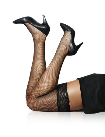 Sexy female legs in net stockings isolated over white Stockfoto