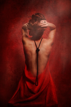 Woman back in red silk with black pearls