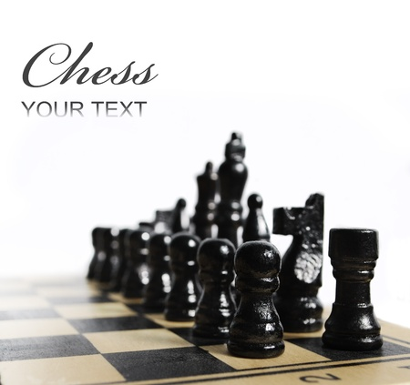xadrez: Black chess pieces on chess board isolated over white Banco de Imagens