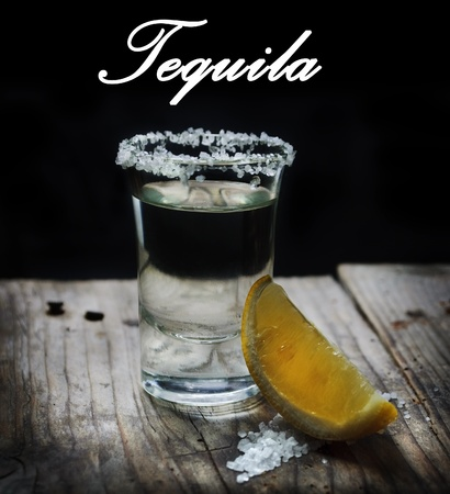 Tequila shot with lemon slice and salt