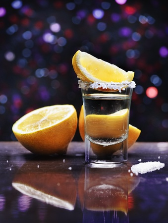 shooter drink: Tequila shot with lemon slice and salt Stock Photo