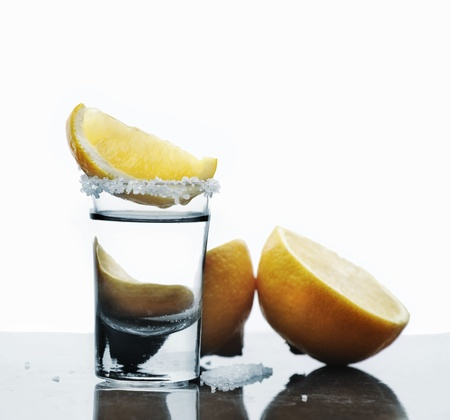 shooter: Tequila shot with lemon slice and salt Stock Photo