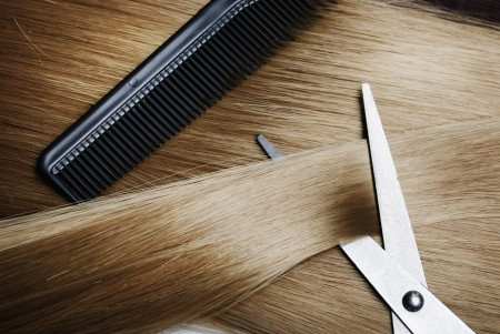 salon:  Long healthy blond hair and professional scissors Stock Photo