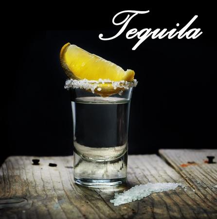 Tequila shot with lemon slice and salt photo