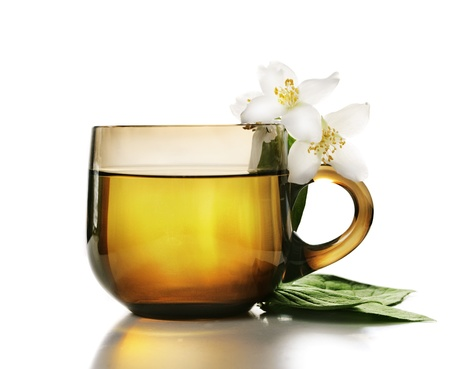 Cup of jasmine tea with white background photo