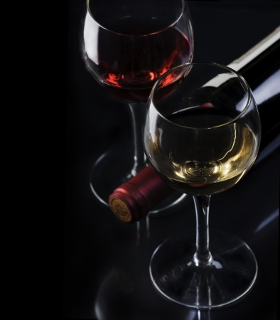 rose wine:  Glass of red and white wine on black background