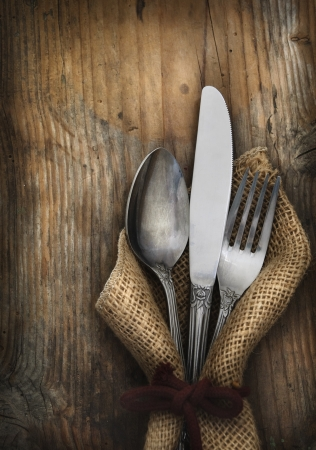 restaurant setting: Vintage silverware on rustick wooden background Stock Photo