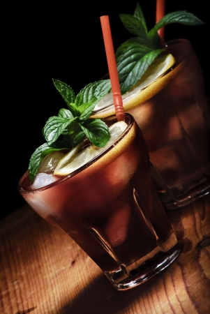 Cuba Libre cocktail on rustic wooden background Stock Photo - 15355595